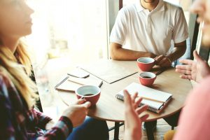 Coffee Network Club introduces a group of professionals having coffee and networking.